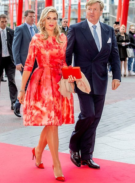 Queen Maxima's outfit is from the fashion house Natan floral print dress. President Michael Higgins and Sabina Higgins