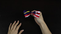 """Diy flag hairbow (super easy) - To fold it you want to make it like an """"m"""" first with the middle scrunching in."""