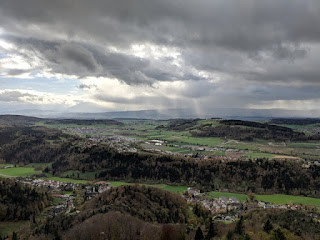 View toward towns in the valleys to the southwest, with rain and storm clouds in the distance, from atop the Uetliberg, Zürich, Switzerland