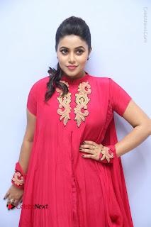 Actress Poorna Latest Stills in Red Dress at Rakshasi First Look Launch  0155.JPG