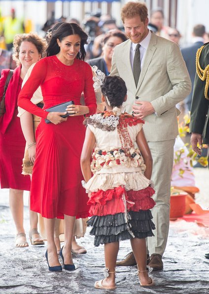 Meghan Markle wore Self-Portrait Pleated Floral Dress, Monolo Blahnik pumps and carried Dior satin clutch. Princess Angelika Latufuipeka