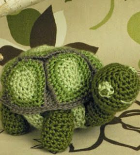 http://www.yarnspirations.com/naturallycaron-files/projects/turtle_toy/turtle_toy.pdf