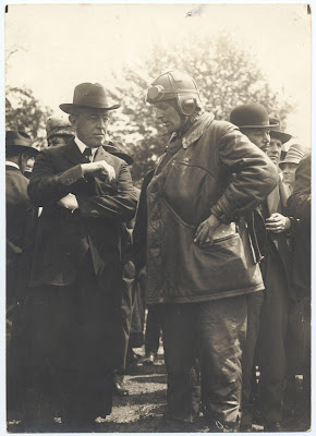 President Woodrow Wilson (left), speaks with Major Reuben H. Fleet, pilot of the first regular air mail flight, at Potomac Park, Washington, D.C.; May 15, 1918.