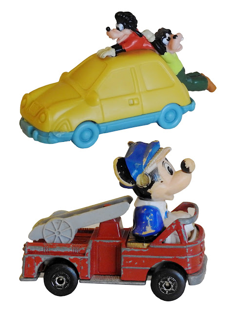 Two toy vehicles, one with Micky Mouse and one with Goofy.