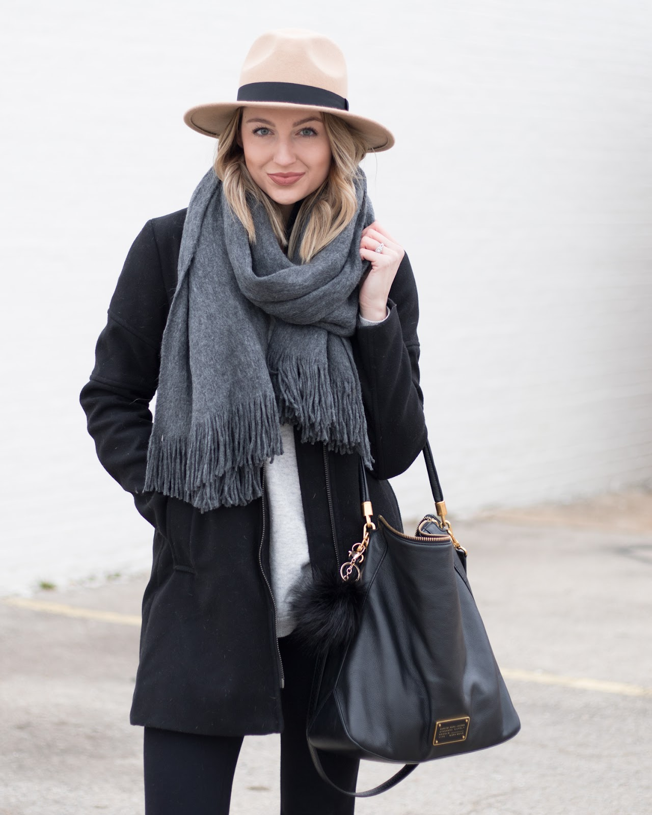 Gray scarf paired with a camel hat