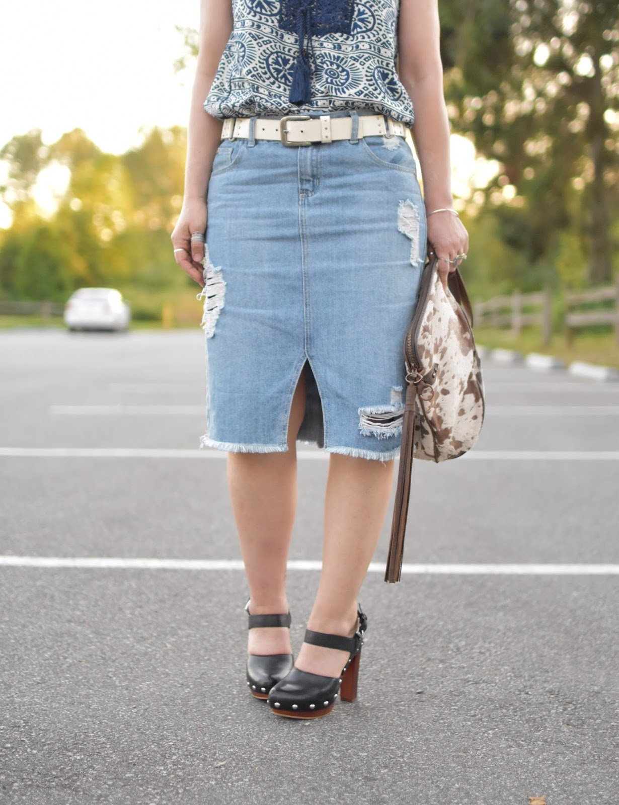 Search and destroy: Distressed denim midi-skirt, peasant top, and ...
