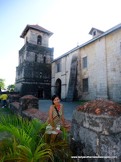 lady outside Baclayon Church Bohol
