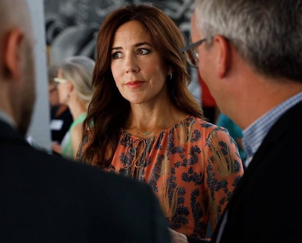 Crown Princess Mary wore a printed silk midi dress by H&M and Prada pumps, she carried Prada Saffiano cuir double bag