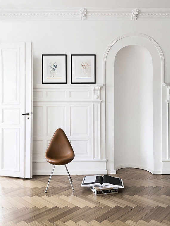 Tan leather Drop Chair by Arne Jacobsen | Image by Christoffer Regild