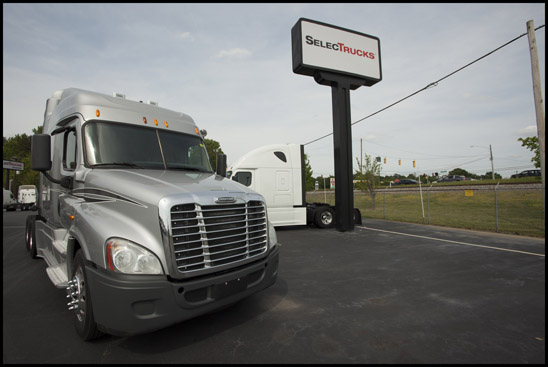 Freightliner Cascadia parked at a Selectrucks dealership