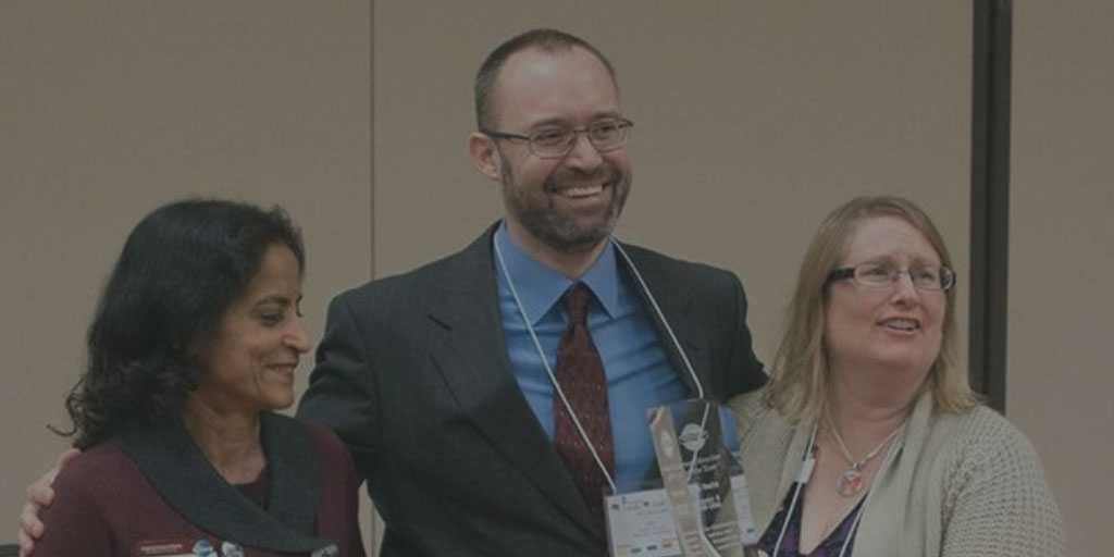 Don accepting the Area Director of the Year award for Toastmasters