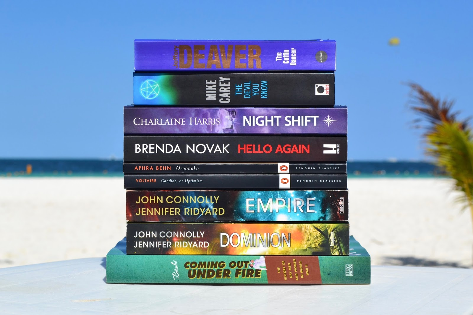 Pile of books on the beach