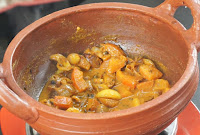 Adding-Tomato-for-dry-fish-Kulambu