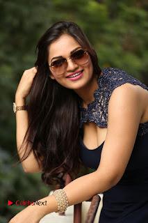 Actress Ashwini Pictures in Short Dress at Vinodam 100 Percent Press Meet  0180.JPG