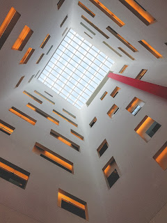 upward view of a geometric ceiling and walls