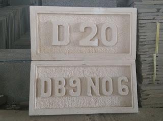 ukiran nomor rumah batu alam