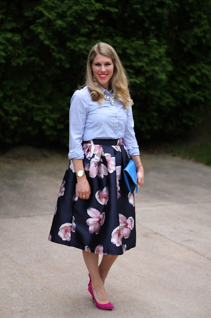 navy floral skirt, pinstripe button up, pink heels, blue Claire V. clutch