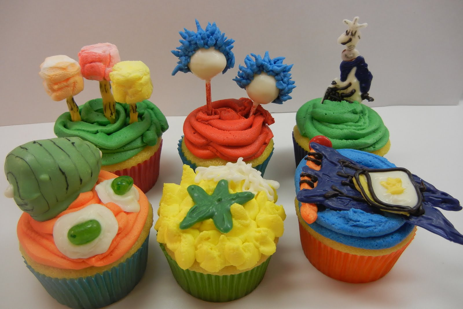 Sugar Swings! Serve Some: a bunch of dr seuss cupcakes....!