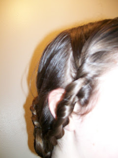Taking the side braid to the back.