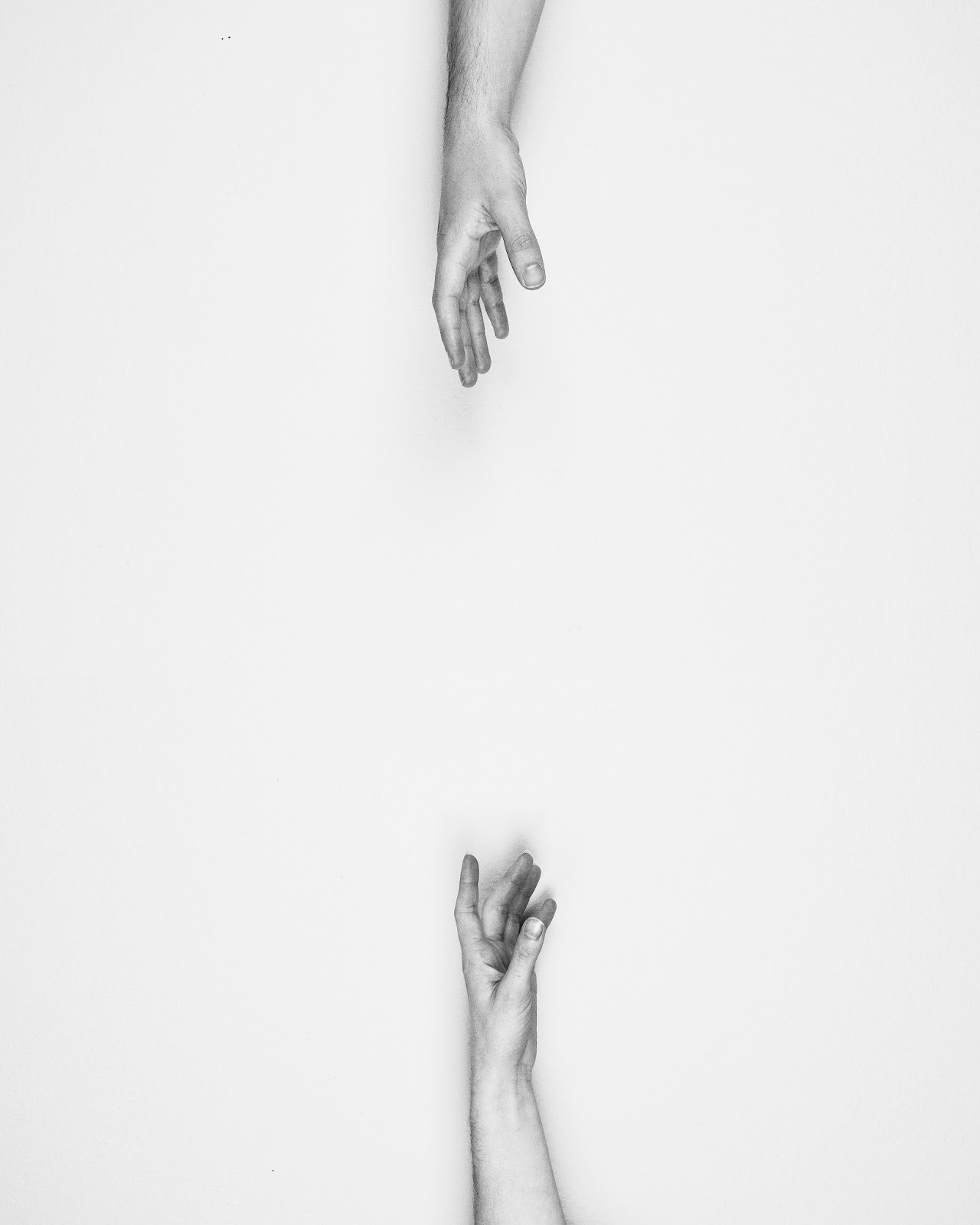 Two hands reaching out for one another