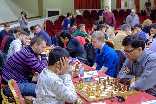 Raunak Sadhwani v Vishy Anand, Alexander Grischuk v Alan Merry Isle of Man Chess International, Round 1, 20 October. Photo by John Saunders