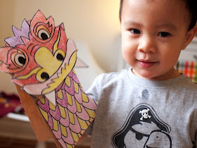 Boy playing with paper bag Chinese New Year Dragon