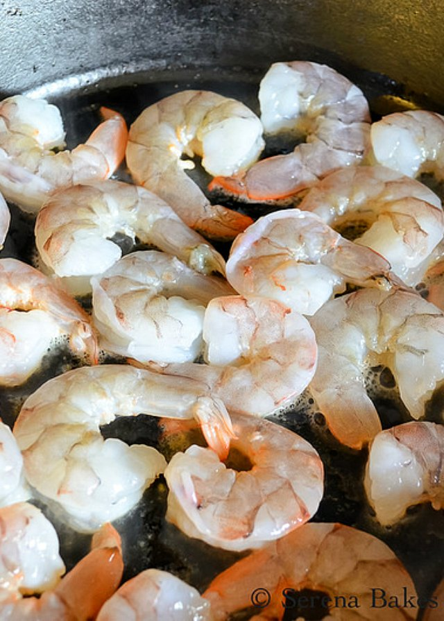 Cook shrimp for Asian Shrimp Black Rice Salad with mango from Serena Bakes Simply From Scratch.