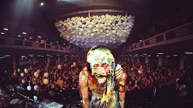 Steve Aoki with a cake face