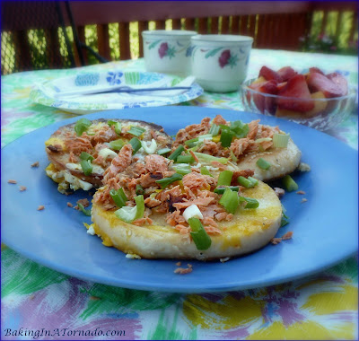 Loaded Egg in a Bagel Basket, an egg cooked in a bagel slice topped with salmon and green onion | Recipe developed by www.BakingInATornado.com | #recipe #breakfast