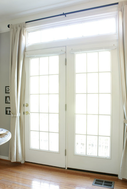 double door with short beige curtains from Ikea.