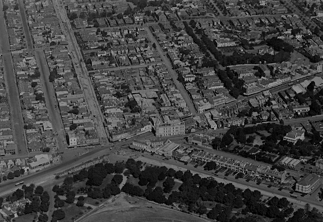 A aerial photograph of St Kilda Junction looking east,  the conversion of the Wellington Street cable tram line is evident, 1925
