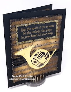 Linda Vich Creates: Rustic Musical Season. Sheet music, distressing and a gold instrument combine to create this vintage Christmas card.