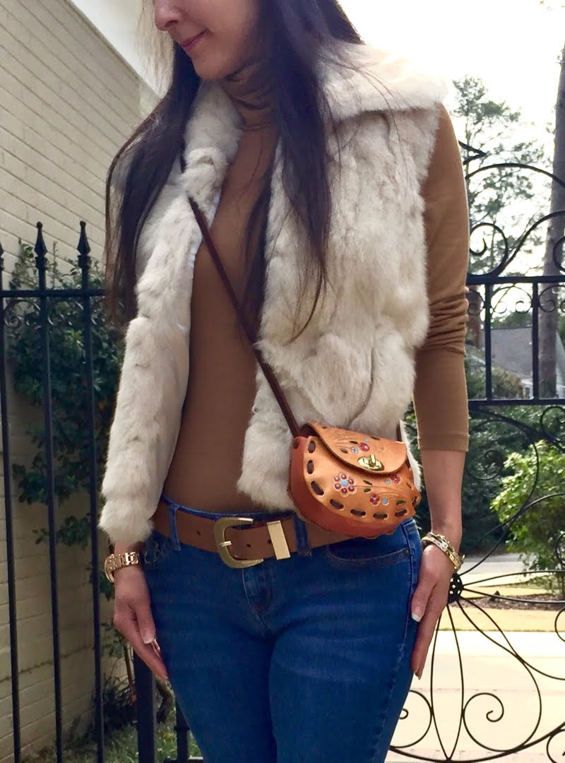 Fur Vest & Skinny Jeans Outfit - up close of center body with watch and bracelets on arms.