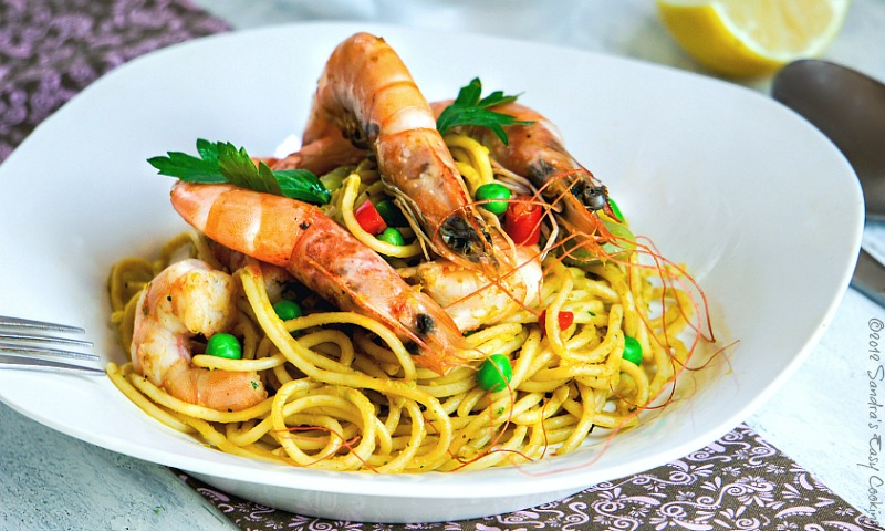 homemade recipe for easy cooking Spaghetti in Peas and Carrot Sauce with Scampi