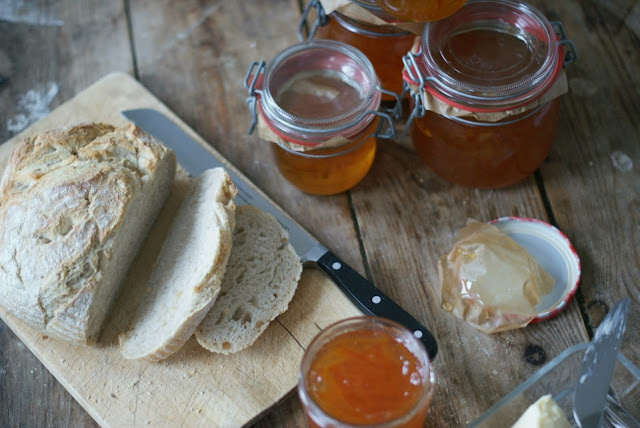 breakfast table with homemade Seville orange marmalade and fresh sourdough bread