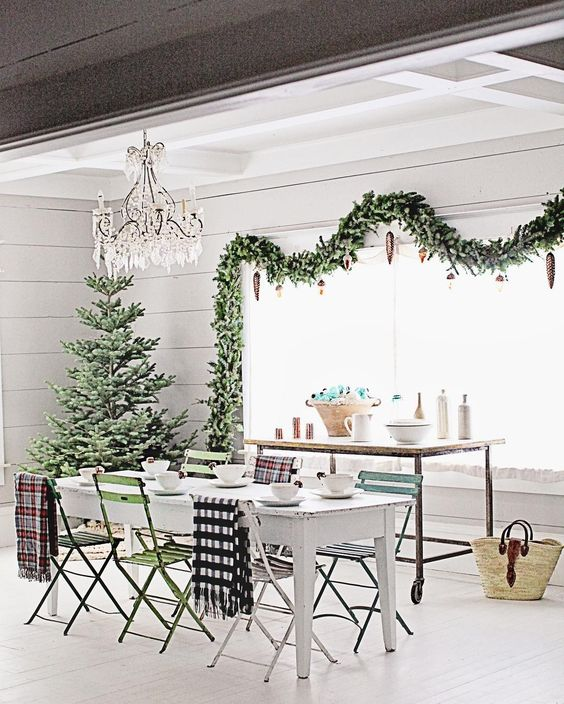 White farmhouse table with fresh greenery and chandelier Farmhouse Christmas holiday decorating shabby chic