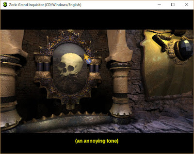 "Screen show of corridor scene with a large skull painting with floating pointer. At the bottom of the screen reads ""an annoying tone"" subtitle in brackets, captioning the sound playing at that moment."