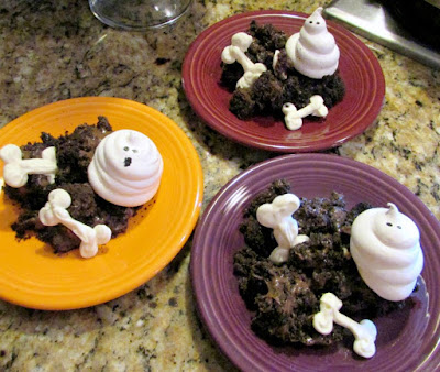 3 dessert plates served with bones, chocolate dirt and meringue ghosts