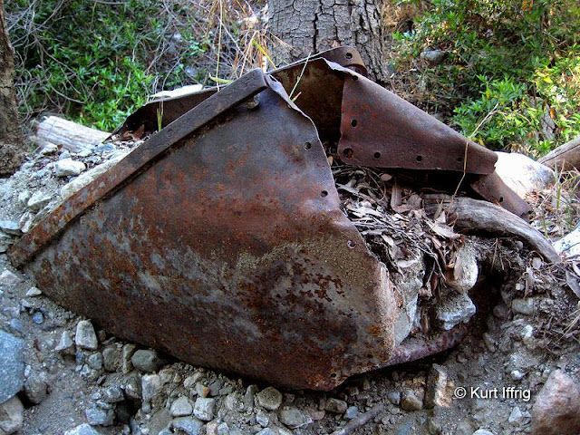 This badly bent ore cart can be found in Allison Gulch, miles below the mine.