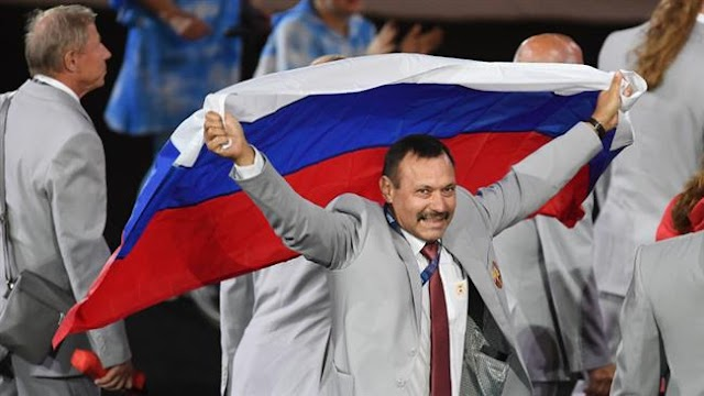Belarusian expelled from Paralympics for carrying Russian tricolor