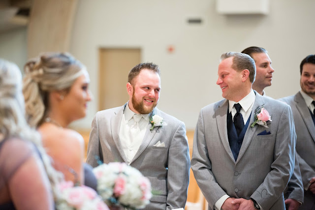 groom crying as bride walks down the isle at St. Paul's Catholic Church in Clinton Township