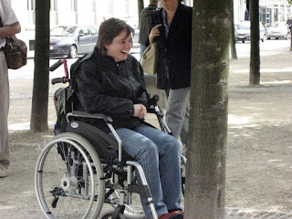 wheelchair facing a tree