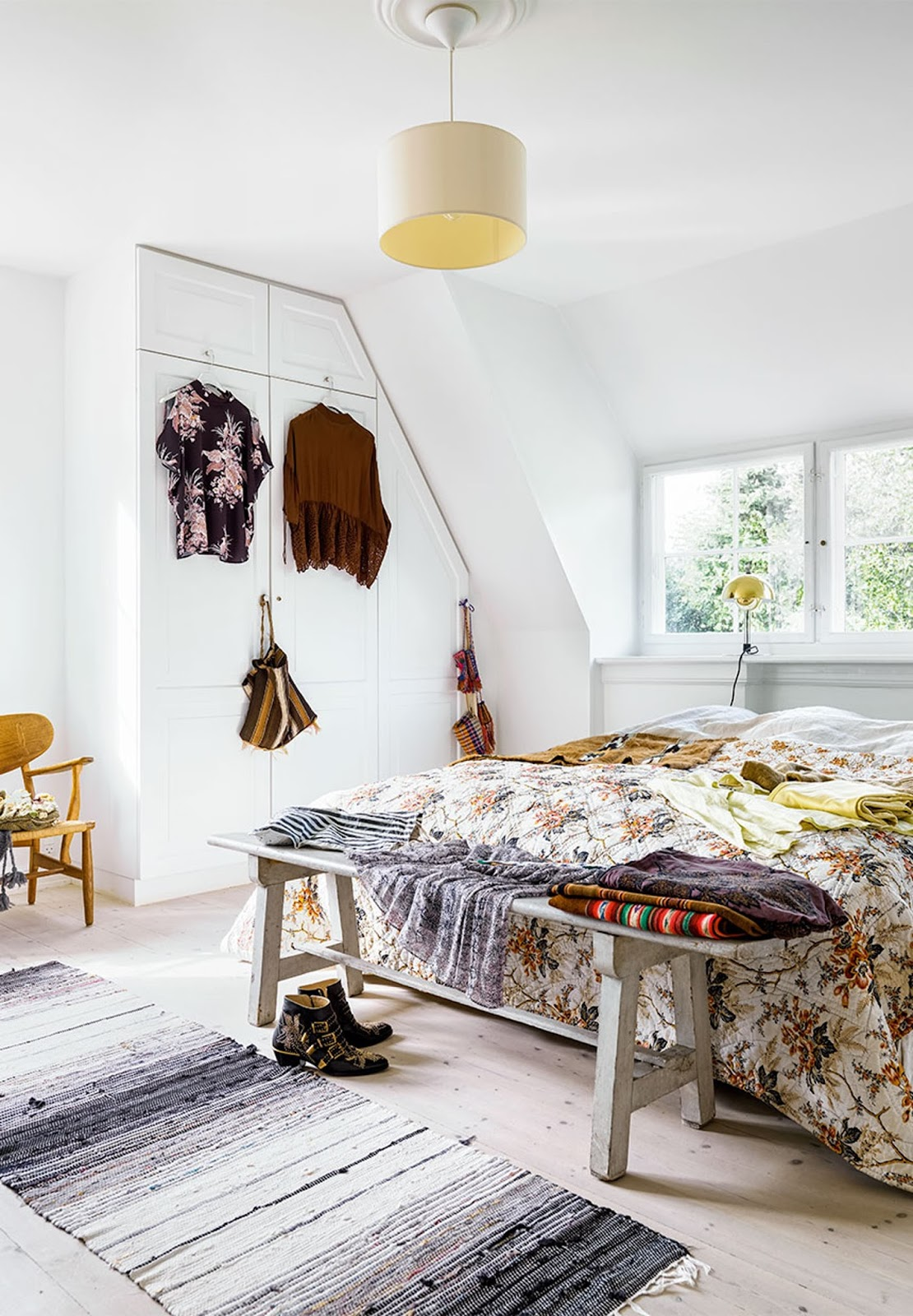 scandinavian interior with colorful rugs, kitchen, oriental bohemian style, eames chairs, art, vintage furniture