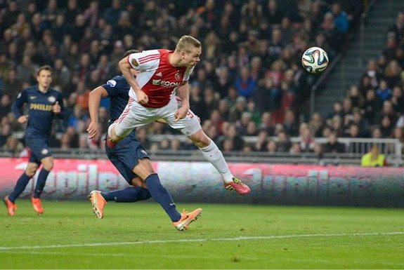 Ajax striker Kolbeinn Sigþórsson heads the ball to score the winning goal against PSV