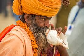 Naga Sadhus Blowing Conch Shell