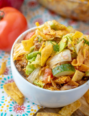 looking down at a bowl of frito taco salad, served and ready to eat