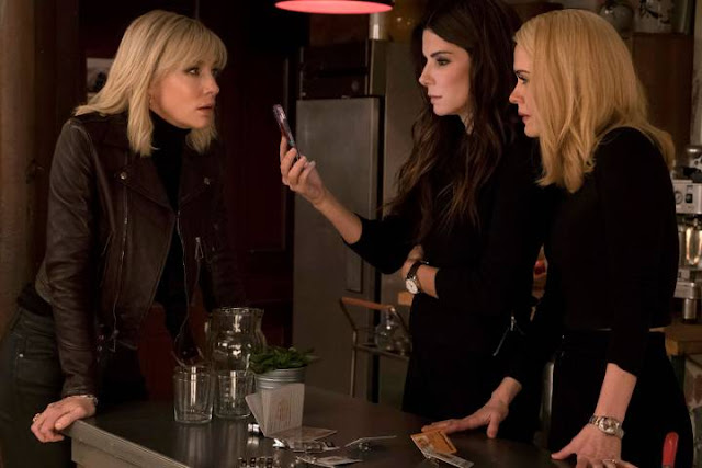 'Ocean's Eight' – A Caper Comedy Sure to Make You Laugh. Sandra Bullock & Anne Hathaway lead an all-star cast in this crime caper. All text © Rissi JC