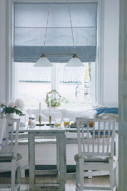 Pastels, white furniture, and built-in banquette in Swedish style kitchen - found on Hello Lovely Studio