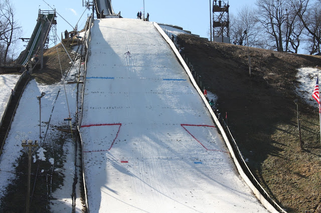 Ski jumper landing at the Norge Ski Jump in Fox River Grove, IL