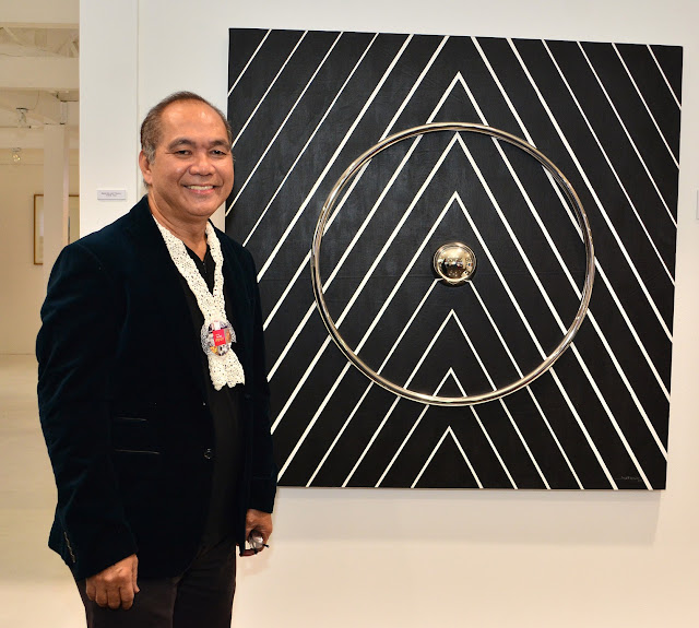"Joe Datuin with his artwork ""Homage to Frank Stella"""